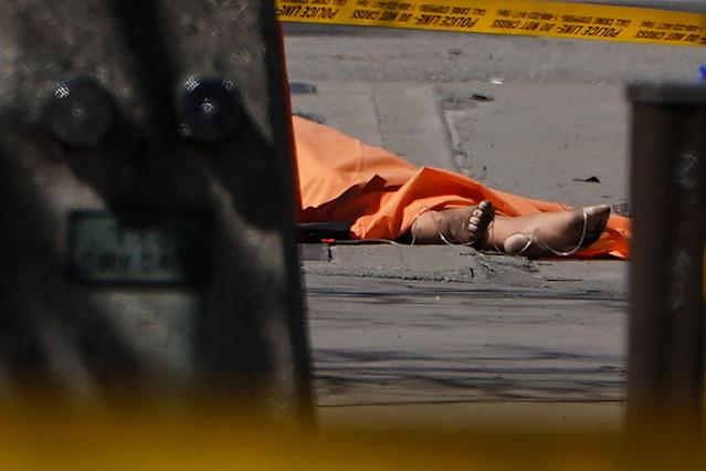 <p>The feet of a victim are pictured at the scene of an incident where a van struck multiple people on Yonge Street in Toronto, Ontario, Canada, April 23, 2018. (Photo: Carlo Allegri/Reuters) </p>