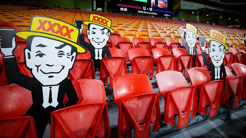 Seen here, cardboard cutouts have replaced real fans in the stands at Suncorp Stadium.