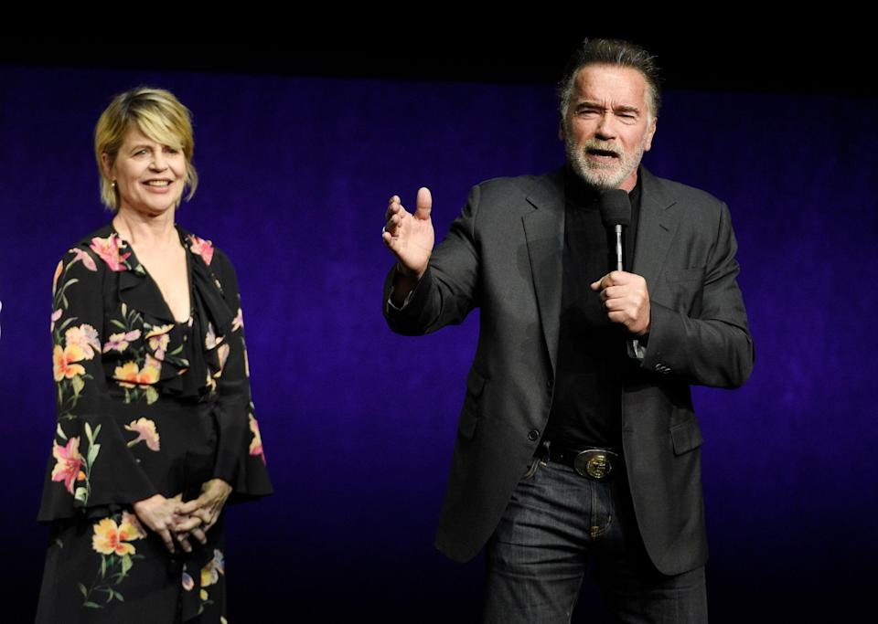 """Arnold Schwarzenegger, right, a cast member in the upcoming film """"Terminator: Dark Fate,"""" talks about the film as fellow cast member Linda Hamilton looks on during the Paramount Pictures presentation at CinemaCon 2019, the official convention of the National Association of Theatre Owners (NATO) at Caesars Palace, Thursday, April 4, 2019, in Las Vegas. (Photo by Chris Pizzello/Invision/AP)"""