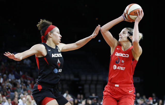Washington Mystics' Elena Delle Donne shoots against Las Vegas Aces' Dearica Hamby during the second half of Game 4 of a WNBA playoff basketball series Tuesday, Sept. 24, 2019, in Las Vegas. (AP Photo/John Locher)