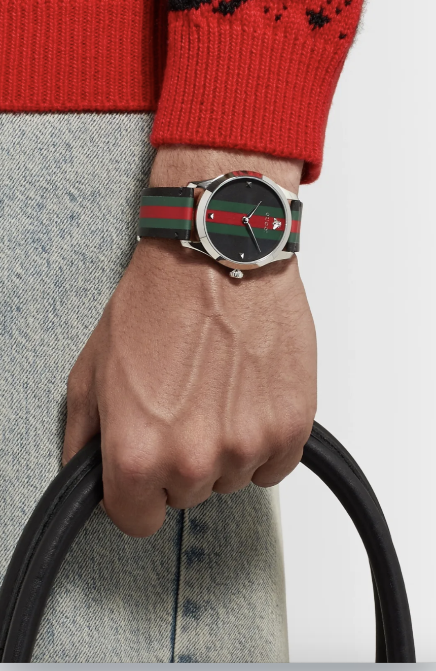 PHOTO: Mr Porter. Gucci G-Timeless 38mm Stainless Steel and Striped Leather Watch