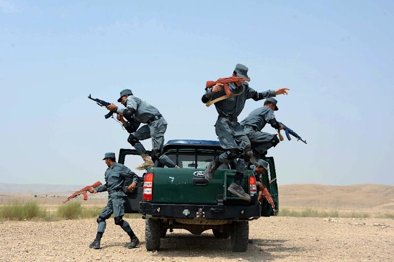 Afghan policemen perform a drill during exercises as part of their graduation ceremony at a police training centre on the outskirts of Jalalabad, in Nangarhar province on August 16, 2015 (AFP Photo/Noorullah Shirzada)
