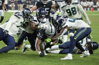 Las Vegas Raiders running back B.J. Emmons is tackled by the Seattle Seahawks during the second half of an NFL preseason football game, Saturday, Aug. 14, 2021, in Las Vegas. (AP Photo/Rick Scuteri)
