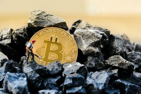 """<span class=""""attribution""""><a class=""""link rapid-noclick-resp"""" href=""""https://www.shutterstock.com/image-photo/cryptocurrency-concept-miners-coins-working-bitcoin-1071938603"""" rel=""""nofollow noopener"""" target=""""_blank"""" data-ylk=""""slk:Anucha Cheechang/Shutterstock"""">Anucha Cheechang/Shutterstock</a></span>"""