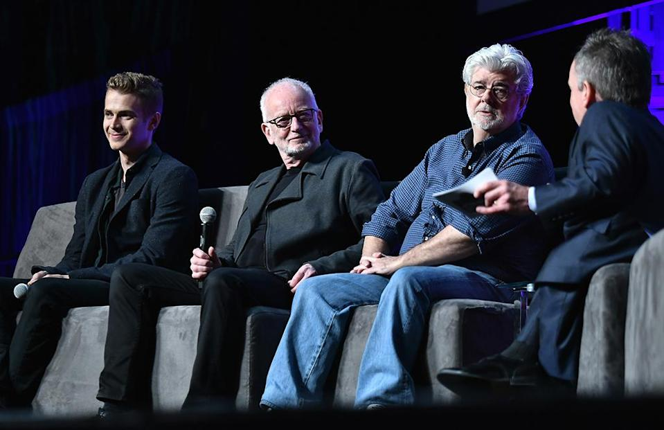 <p>Warwick Davis (Wicket from <em>Return of the Jedi</em>) emceed the panel that included (from left) Hayden Christensen, Ian McDiarmid, and George Lucas. (Photo: Gustavo Caballero/Getty Images) </p>