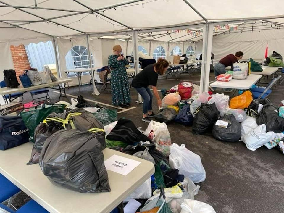 Donations being sorted in the car park of the Bushey United Synagogue (Bushey United Synagogue) (PA Media)