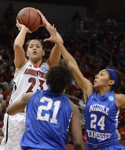 Louisville's Shoni Schimmel, left, puts a shot up over the defense of Middle Tennessee's Ebony Rowe, center, and Kortni Jones during the second half of a first-round game in the women's NCAA college basketball tournament in Louisville, Ky., Sunday March 24, 2013. Louisville defeated Middle Tennessee 74-49. (AP Photo/Timothy D. Easley)