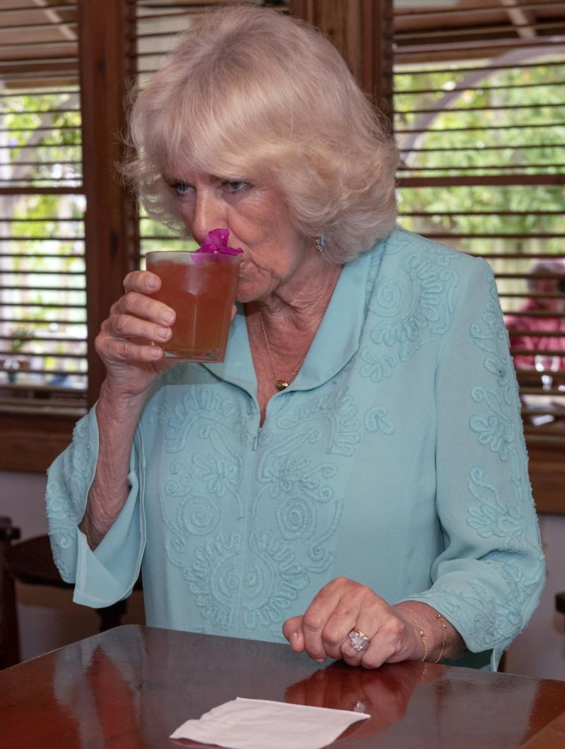 Camilla Parker Bowles taking a sip of rum punch during a visit to the Hermitage Plantation House in Saint Kitts and Nevis, March 2019.
