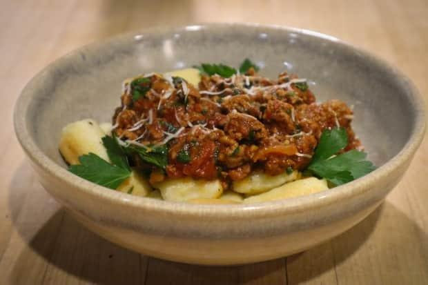 The finished product from Kathryn Joel's cooking class featuring gnocchi parisienne topped with a lamb ragu sauce. (Submitted by Kathryn Joel - image credit)