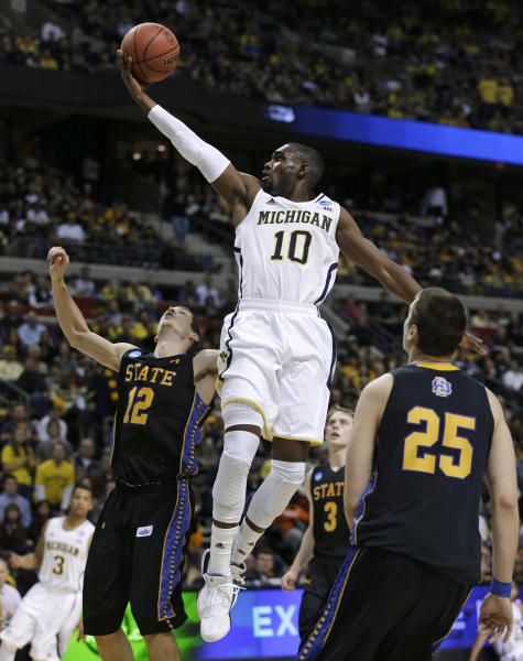 Michigan guard Tim Hardaway Jr. (10) drives against South Dakota State guard Brayden Carlson (12) in the second half of a second-round game of the NCAA men's college basketball tournament in Auburn Hills, Mich., Thursday, March 21, 2013. Michigan won 71-56. (AP Photo/Paul Sancya)