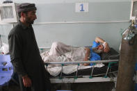 An injured man is treated at a hospital after a car bomb attack in Herat province, west of Kabul, Afghanistan, Saturday, March 13, 2021. A powerful car bomb killed numerous people and injured dozens more in Afghanistan's western Herat province, officials said Saturday. (AP Photo/Hamed Sarfarazi)