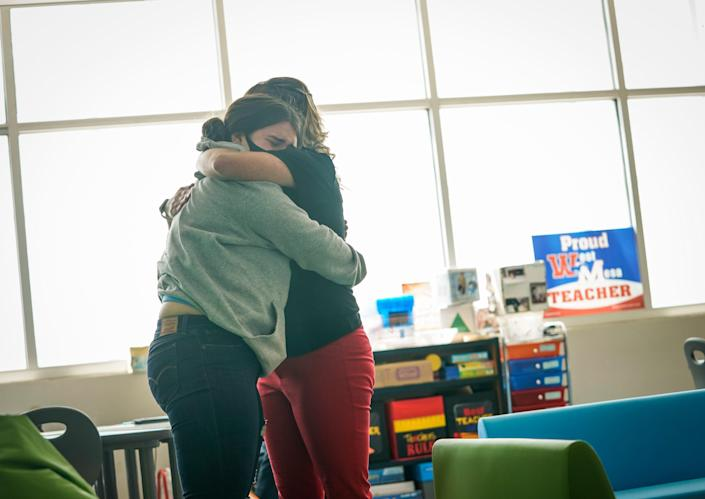 Stephanie Davy comforts a student during health class.