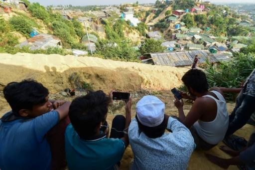 Rohingya refugees in Bangladesh watch a live feed of Aung San Suu Kyi's appearance at the UN