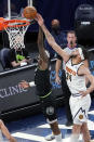 Denver Nuggets' JaVale McGee (34) knocks away a layup by Minnesota Timberwolves' Jarred Vanderbilt during the first half of an NBA basketball game Thursday, May 13, 2021, in Minneapolis. (AP Photo/Jim Mone)