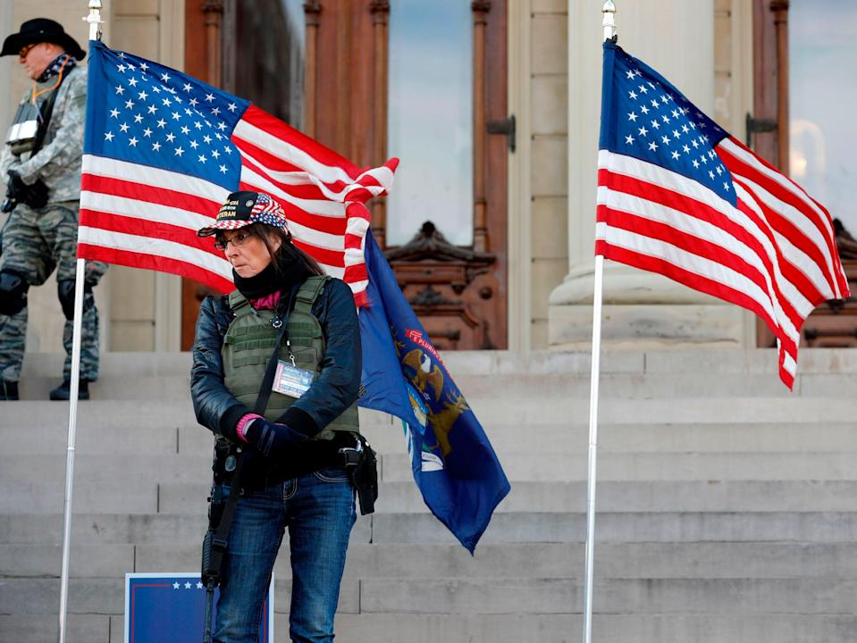 """People gather at the Michigan State Capitol for a """"Stop the Steal"""" rally in support of US President Donald Trump on 14 November 2020, in Lansing, Michigan. - Supporters are backing Mr Trump's false claim that the 3 November election was fraudulent (AFP via Getty Images)"""