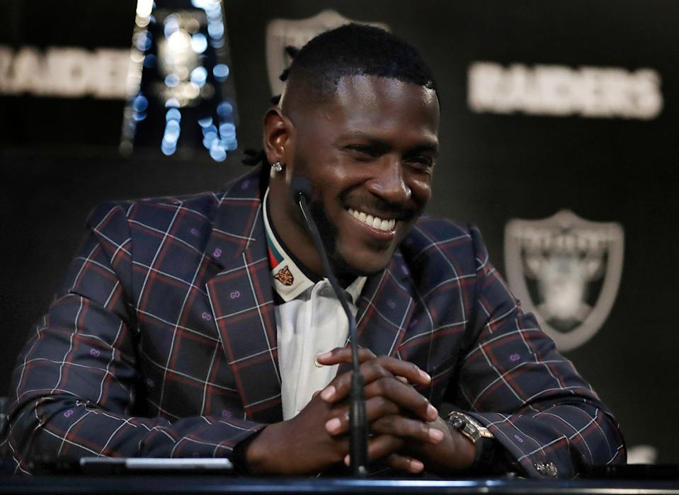 Oakland Raiders wide receiver Antonio Brown smiles during an NFL football news conference (AP Photo)