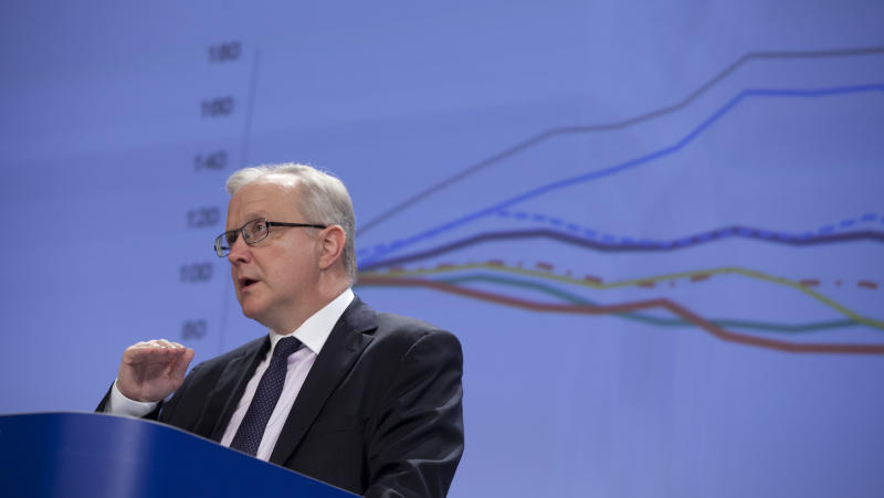 """European Commissioner for Economic Affairs Olli Rehn speaks during a media conference at EU headquarters in Brussels on Wednesday, April 10, 2013. The European Commission is warning that Spain and Slovenia face """"excessive"""" problems balancing their economies. In a health-check of the economies of 13 European Union countries, the Commission said Wednesday that """"high domestic and external debt levels continue to pose serious risks for growth and financial stability"""" in Spain. (AP Photo/Virginia Mayo)"""