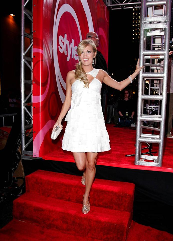 "Country queen Carrie Underwood is a vision in white. James Devaney/<a href=""http://www.wireimage.com"" target=""new"">WireImage.com</a> - September 6, 2007"