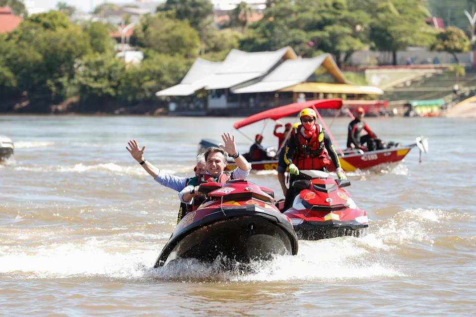 Brazil's President Jair Bolsonaro rides a jet ski with Goias governor Ronaldo Caiado on Araguaia river as they attend the launch of Project Together for Araguaia in Aragarcas, Goias state, Brazil June 5, 2019. Alan Santos/Brazilian Presidency/Handout via REUTERS.THIS IMAGE HAS BEEN SUPPLIED BY A THIRD PARTY. IT IS DISTRIBUTED, EXACTLY AS RECEIVED BY REUTERS, AS A SERVICE TO CLIENTS