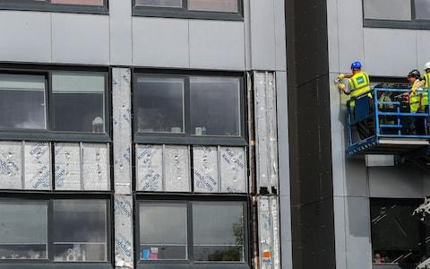 """A report has said the Government is """"still not doing enough"""" to remove dangerous cladding from buildings more than two years on from the Grenfell Tower tragedy - Credit: Peter Byrne/PA"""