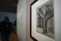"""A photographer takes pictures of Study for """"Worn Out"""", a drawing by Dutch master Vincent van Gogh, dated Nov. 1882, on public display for the first time at the Van Gogh Museum in Amsterdam, Netherlands, Thursday, Sept. 16, 2021. (AP Photo/Peter Dejong)"""