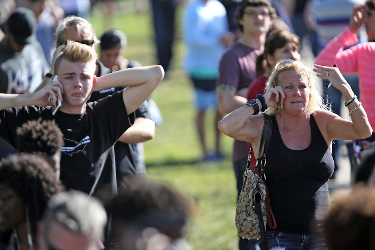 Waiting for word from students at Coral Springs Drive and the Sawgrass Expressway just south of the campus of Stoneman Douglas High School in Parkland, Fla., after a shooting on Wednesday, Feb. 14, 2018. (Amy Beth Bennett/Sun Sentinel/TNS via Getty Images)