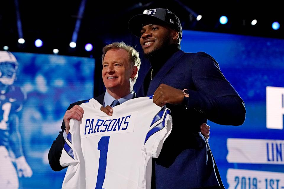 Micah Persons (Penn State) with NFL commissioner Roger Goodell after being selected by the Dallas Cowboys as the number 12 overall pick in the first round of the 2021 NFL Draft at First Energy Stadium.