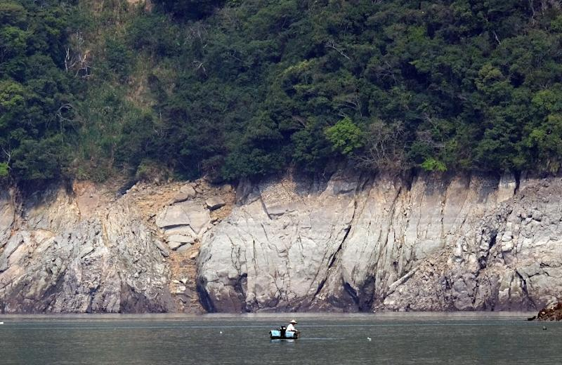 A local resident is seen fishing at Shihman dam in northern Taoyuan, on March 20, 2015 (AFP Photo/Sam Yeh)