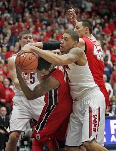 Arizona's Brandon Ashley, front right, and Utah's Aaron Dotson, front left, and Jason Washburn (42) struggle for control of the ball during the first half of an NCAA college basketball game at McKale Center in Tucson, Ariz., Jan. 5, 2013. Arizona won 60-57. (AP Photo/John Miller)