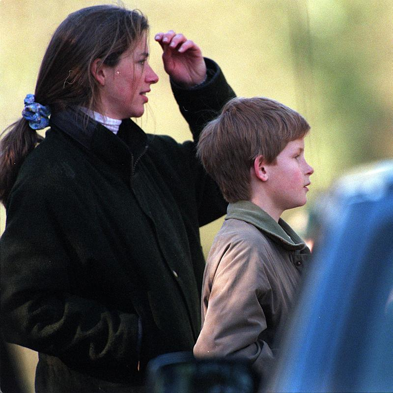 MALMESBURY-MARCH: (FILE PHOTO) Prince Harry and Tiggy Legge-Bourke watch Charles, Prince of Wales, take part in the Beaufort Hunt in March 1997 in Malmesbury, England. (Photo by Anwar Hussein/Getty Images)