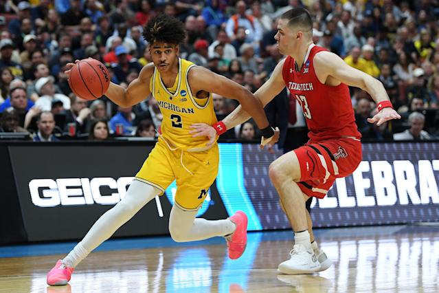 <p>Jordan Poole #2 of the Michigan Wolverines drives against Matt Mooney #13 of the Texas Tech Red Raiders during the 2019 NCAA Men's Basketball Tournament West Regional at Honda Center on March 28, 2019 in Anaheim, California. (Photo by Harry How/Getty Images) </p>