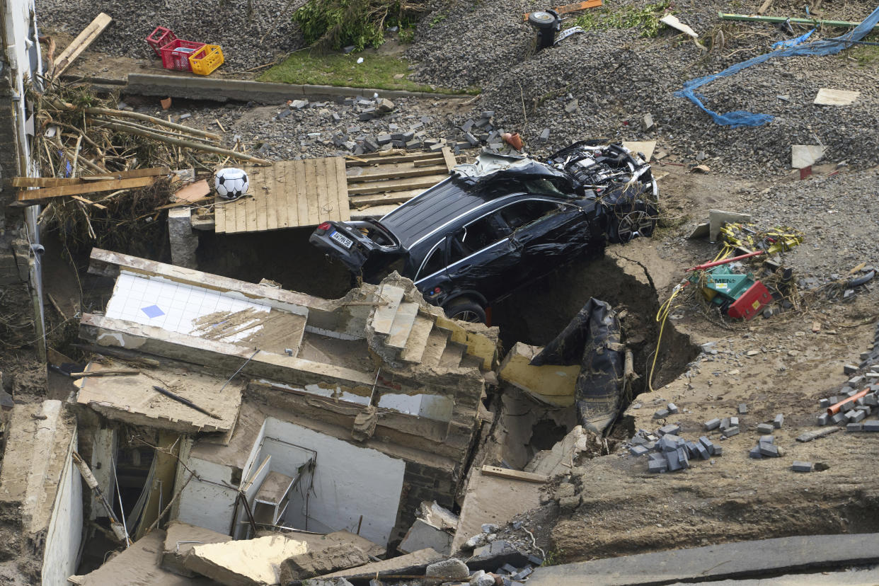 Houses and cars in the Ahr valley in the Walporzheim district are destroyed in Bad Neuenahr-Ahrweiler, Germany, Saturday, July 17, 2021. Clean-up work begins in the areas affected by the storm. Days of heavy rain in Western Europe turned normally minor rivers and streets into raging torrents this week and caused the disastrous flooding that swept away cars, engulfed homes and trapped residents. (Thomas Frey/dpa via AP)