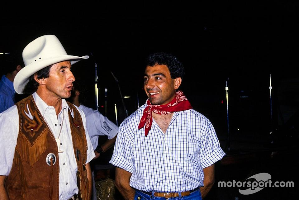 "Sir Jackie Stewart and Alboreto – the Tyrrell team's first F1 winner and final F1 winner. We'll assume they're attempting to look inconspicuous while mingling with the natives, since this was taken in Phoenix in '89. <span class=""copyright"">Ercole Colombo</span>"