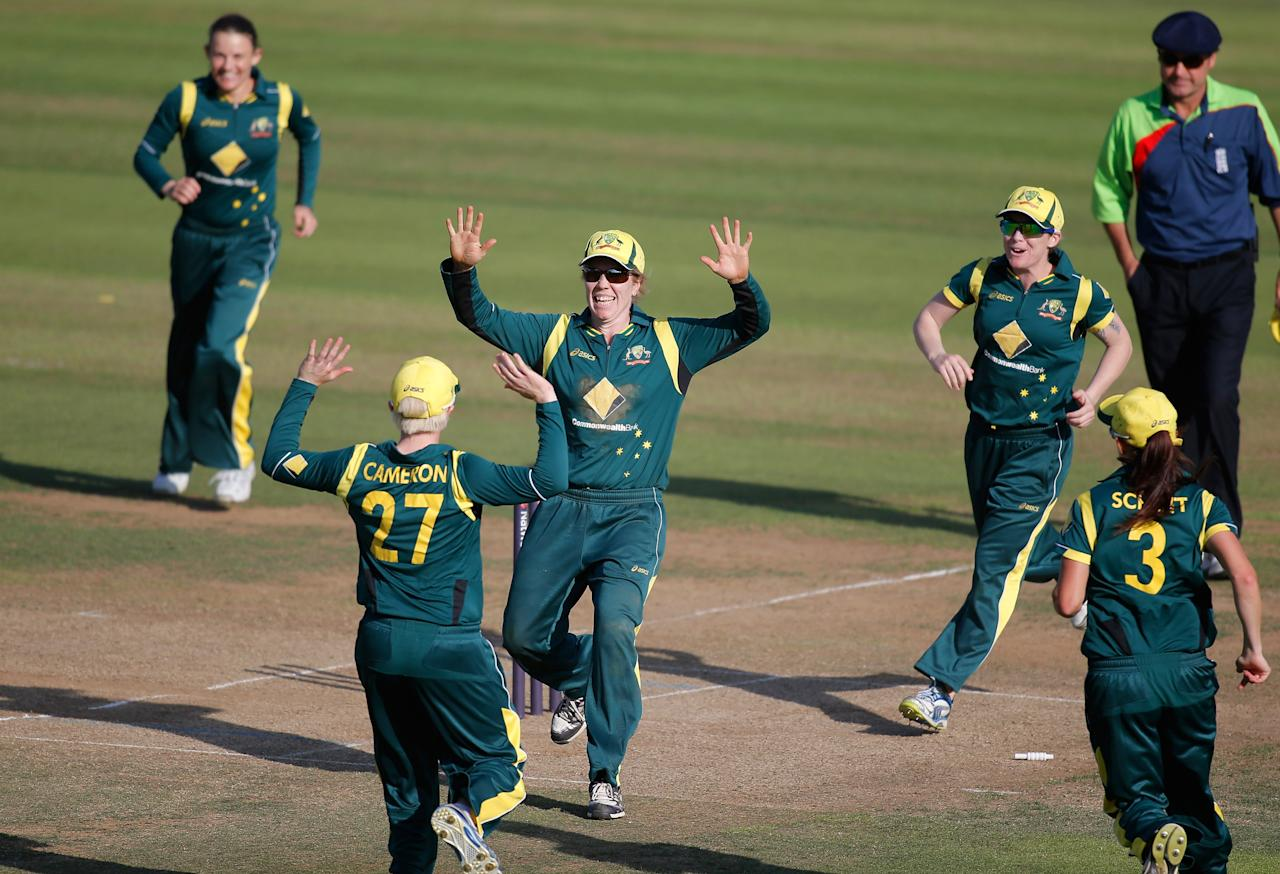 LONDON, ENGLAND - AUGUST 20:  Alex Blackwell of Australia (C) celebrates with teammates after running out Laura Marsh of England (not pictured) during the first NatWest One Day International match between England and Australia at Lord's Cricket Ground on August 20, 2013 in London, England.  (Photo by Harry Engels/Getty Images)
