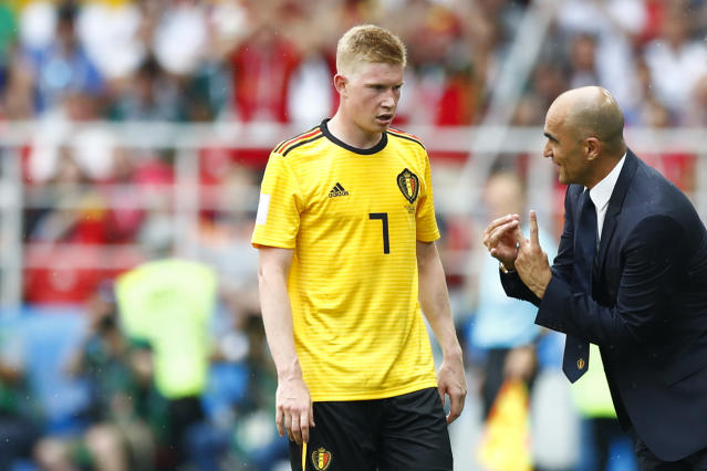 Belgium coach Roberto Martinez, right, talks to Belgium's Kevin De Bruyne during the group G match between Belgium and Tunisia at the 2018 soccer World Cup in the Spartak Stadium in Moscow, Russia, Saturday, June 23, 2018. (AP Photo/Matthias Schrader)