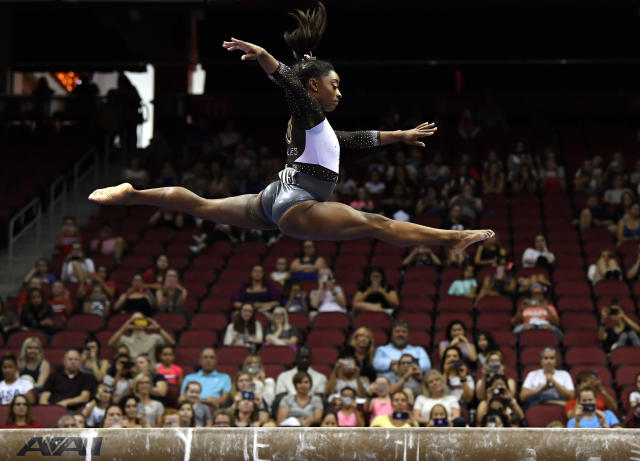 Simone Biles performs her balance beam routine during the GK US Classic gymnastics meet in Louisville, Ky., Saturday, July 20, 2019. (AP Photo/Timothy D. Easley)