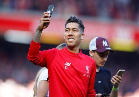 Soccer Football - Premier League - Liverpool vs Brighton & Hove Albion - Anfield, Liverpool, Britain - May 13, 2018 Liverpool's Roberto Firmino celebrates after the match REUTERS/Phil Noble