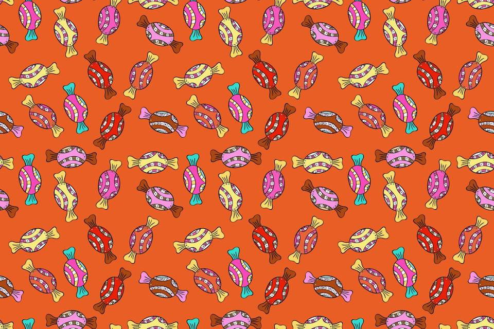 orange wallpaper with little pieces of all different colored candy
