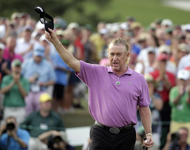 Miguel Angel Jimenez, of Spain, holds up his visor on the 18th hole following his fourth round of the Masters golf tournament Sunday, April 13, 2014, in Augusta, Ga. (AP Photo/Chris Carlson)