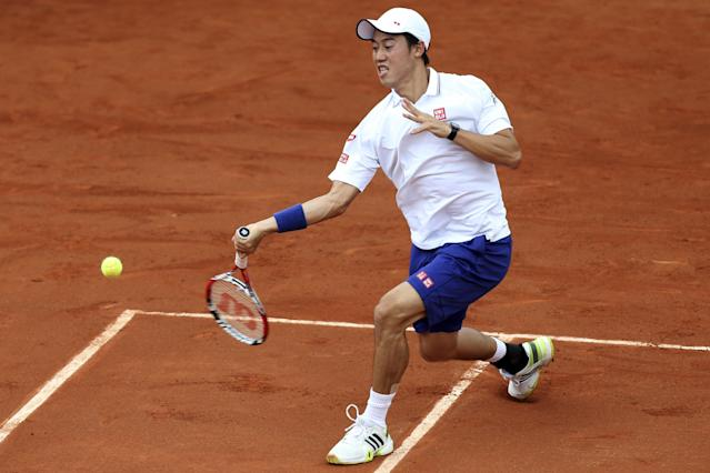 Japan's Kei Nishikori returns the ball during the first round match of the French Open tennis tournament against Slovakia's Martin Klizan at the Roland Garros stadium, in Paris, France, Monday, May 26, 2014. (AP Photo/David Vincent)