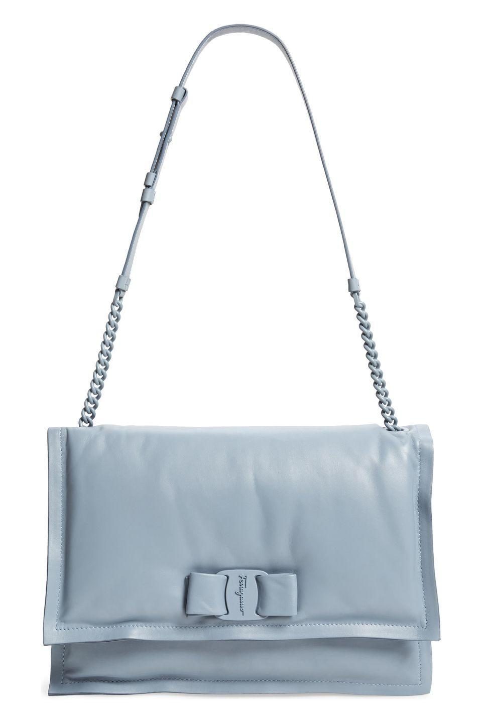 "<p>Salvatore Ferragamo's new Viva Bow bag could double as a pillow if you're in a sleepy pinch. The soft padded bag follows the puffed up purse trend we've all been loving, but offers a feminine touch in baby blue and a sweet bow detail. </p><p><em>Salvatore Ferragamo , $1,250; salvatoreferragamo.com</em></p><p><a class=""link rapid-noclick-resp"" href=""https://www.ferragamo.com/shop/us/en/women/handbags/hobos-shoulder-bags/viva-736924"" rel=""nofollow noopener"" target=""_blank"" data-ylk=""slk:SHOP NOW"">SHOP NOW</a></p>"