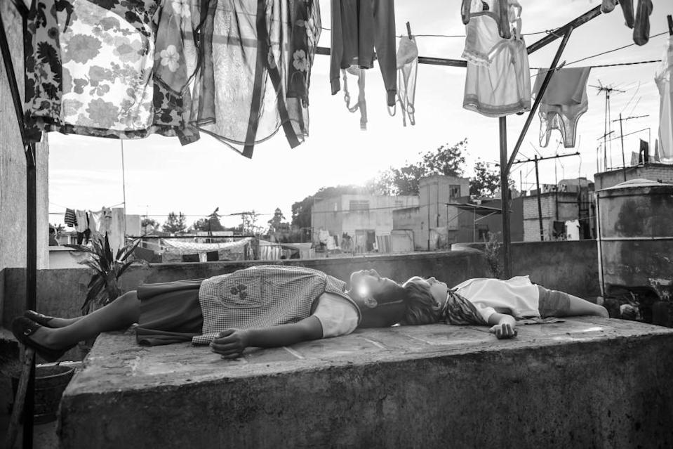 "This image released by Netflix shows a scene from the film ""Roma,"" by filmmaker Alfonso Cuaron, which will have an exclusive run in theaters before becoming available on Netflix's streaming service. (Netflix via AP)"