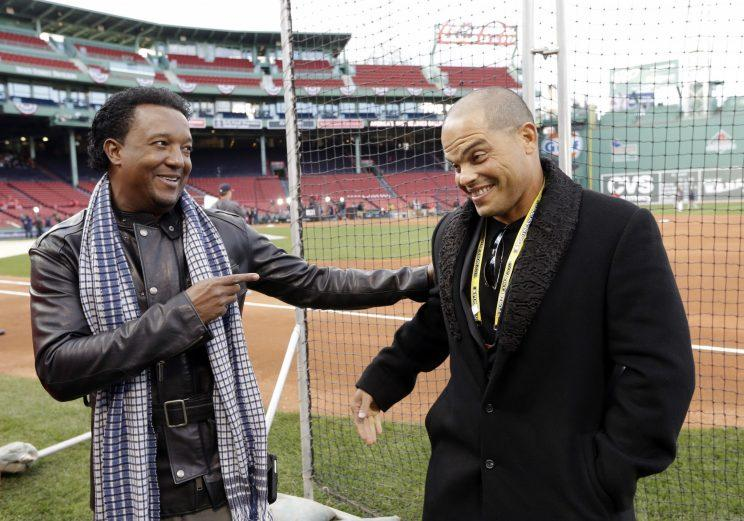 Pedro Martinez and Iván Rodríguez appeared in a few All-Star Games together. (AP Photo)
