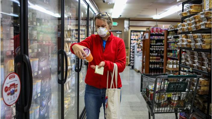 Woman shops for groceries
