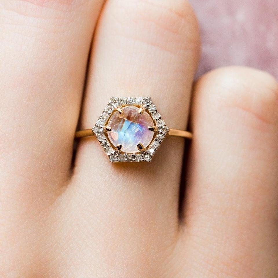 """<p>They'll get all the sparkle and glow they could ever ask for with the <a href=""""https://www.popsugar.com/buy/Solid-Gold-Moonstone-Diamond-Hexagon-Ring-531201?p_name=Solid%20Gold%20Moonstone%20and%20Diamond%20Hexagon%20Ring&retailer=localeclectic.com&pid=531201&price=1%2C045&evar1=fab%3Aus&evar9=44555978&evar98=https%3A%2F%2Fwww.popsugar.com%2Fphoto-gallery%2F44555978%2Fimage%2F47011750%2FSolid-Gold-Moonstone-Diamond-Hexagon-Ring&list1=wedding%2Cjewelry%2Crose%20gold%2Cengagement%20rings&prop13=api&pdata=1"""" rel=""""nofollow noopener"""" class=""""link rapid-noclick-resp"""" target=""""_blank"""" data-ylk=""""slk:Solid Gold Moonstone and Diamond Hexagon Ring"""">Solid Gold Moonstone and Diamond Hexagon Ring</a> ($1,045).</p>"""