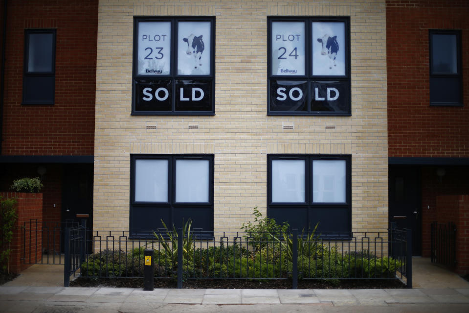 Sold new build homes are seen on a development in south London June 3, 2014. Britain's house prices rose at their fastest annual pace in nearly seven years last month and signs of bottlenecks in the construction sector underscored the upward pressures on the market, surveys showed on Tuesday. House price growth picked up to an annual pace of 11.1 percent in May, mortgage lender Nationwide said, fanning concerns that the property market could be overheating.  REUTERS/Andrew Winning   (BRITAIN - Tags: POLITICS BUSINESS REAL ESTATE)