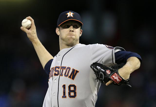 Houston Astros starting pitcher Jordan Lyles works against the Texas Rangers in the first inning of a baseball game, Monday, Sept. 23, 2013, in Arlington, Texas. (AP Photo/Tony Gutierrez)