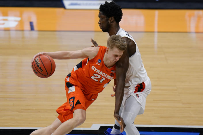 Syracuse forward Marek Dolezaj, left, runs into San Diego State forward Nathan Mensah during the second half of a college basketball game in the first round of the NCAA tournament at Hinkle Fieldhouse in Indianapolis, Friday, March 19, 2021. (AP Photo/AJ Mast)