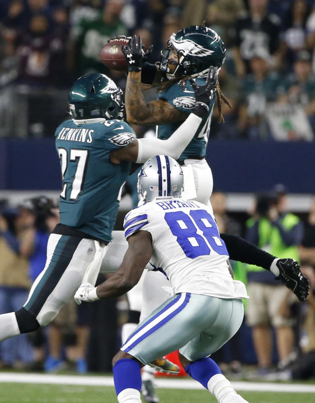 <p>Philadelphia Eagles safety Malcolm Jenkins (27) and Dallas Cowboys wide receiver Dez Bryant (88) watch as the Eagles' Ronald Darby, top, intercepts a pass intended for Bryant in the first half of an NFL football game, Sunday, Nov. 19, 2017, in Arlington, Texas. (AP Photo/Ron Jenkins) </p>