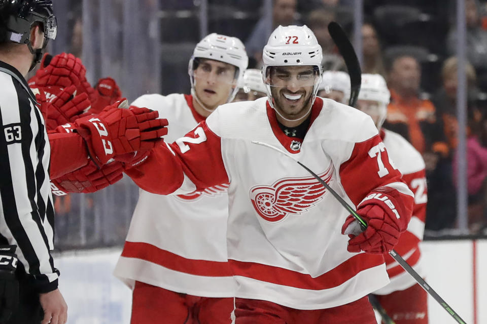Detroit Red Wings center Andreas Athanasiou celebrates after scoring against the Anaheim Ducks during the second period of an NHL hockey game in Anaheim, Calif., Tuesday, Nov. 12, 2019. (AP Photo/Chris Carlson)